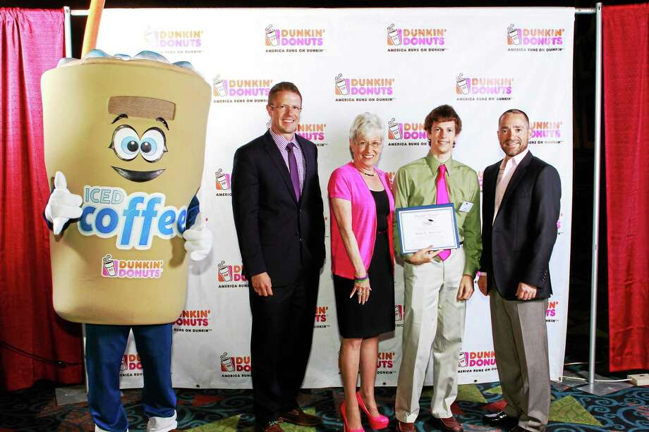 Dunkin' Donuts Scholarship recipient Philip Anderson is pictured with event emcee Mark Dixon, Lt. Gov. Nancy Wyman and Dunkin' Donuts franchisee Michael Batista. Photo: Submitted Photo  / Rich Morganstern