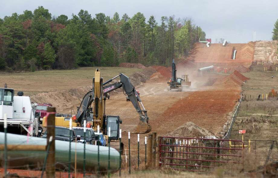 AP Photo/Tyler Morning Telegraph, Sarah A. Miller, File In a Dec. 3, 2012 photo, crews work on construction of the TransCanada Keystone XL Pipeline near County Road 363 and County Road 357, east of Winona, Texas. Photo: AP / Tyler Morning Telegraph