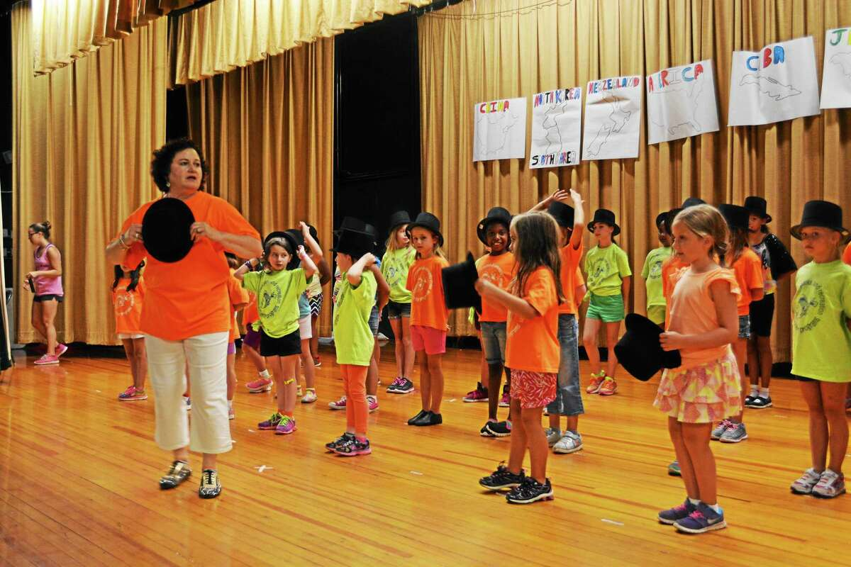 Participants of Middletown's summer dance camp at perform a routine with top hats, choreographed and led by Lynn Agnew.