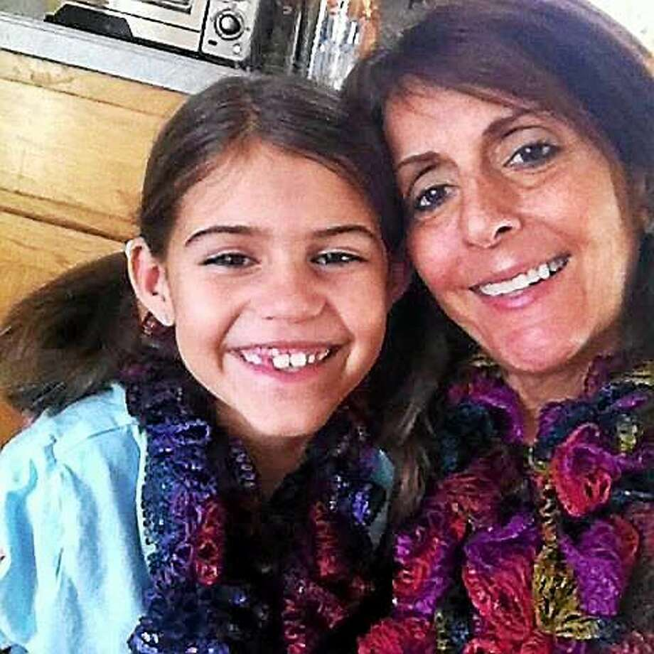 Middletown resident Trish Ghezzi, living with stage four lung cancer, is shown with her daughter, Jalena, 9. Photo: Courtesy Trish Ghezzi