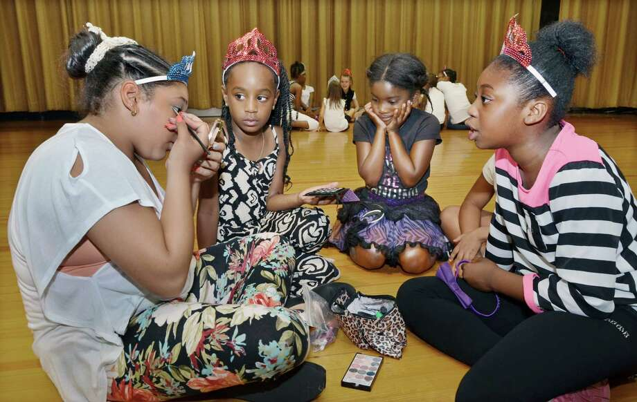 "Dancers in the Middletown Summer Dance Camp watch one of the older campers put on her own make-up shortly before their dance recital, ""New York, New York,"" at the Snow School auditorium Friday afternoon. Camp director Lynn Agnew and choreographers Haley McDonald, Alissa Lancia, Marisa Bishop, Cassidy Zanette, Caitlin Nelson and Lynn Agnew prepared the girls all week to put on a show for parents and guests. Photo: Catherine Avalone — The Middletown Press"