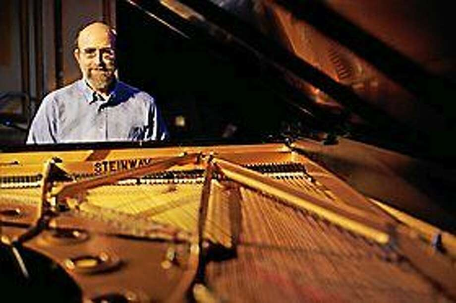 Contributed photo Pianist George Winston, whose shows benefit charities, is appearing at The Kate. Photo: Journal Register Co.