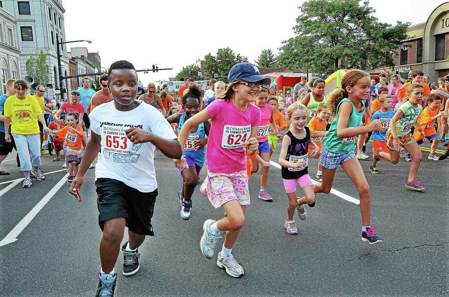 Catherine Avalone -The Middletown Press The Citizens Bank 5K Summer Fun Run and 1/2 Mile Kids Fun Run was held July 23 on Main Street in Middletown. Photo: Journal Register Co.