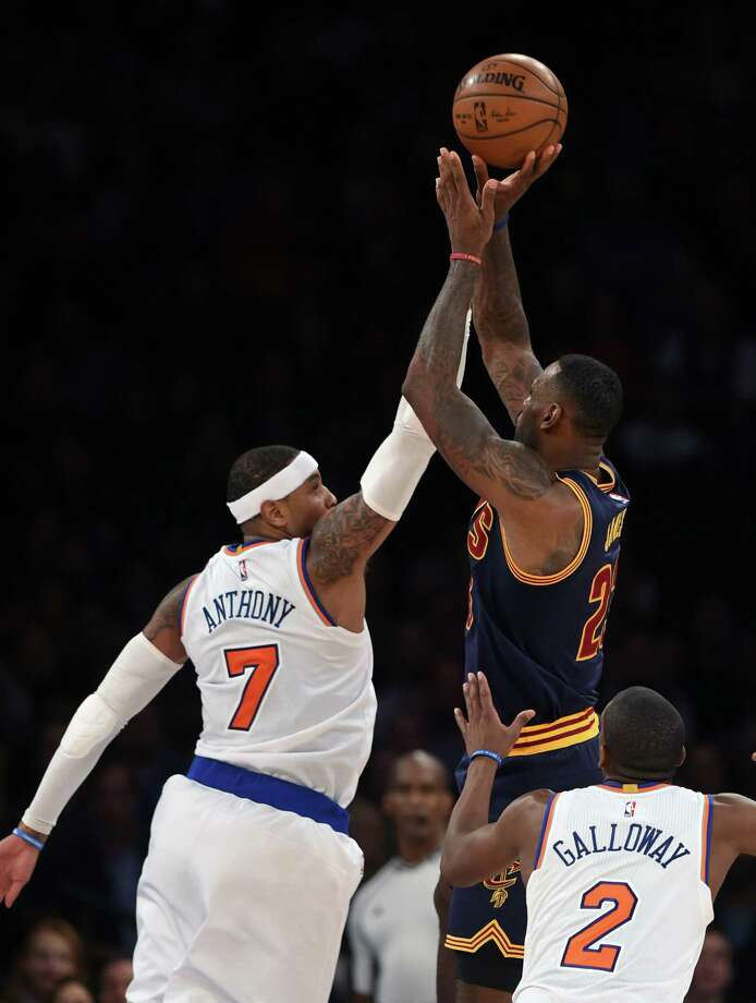 Cleveland Cavaliers forward LeBron James (23) shoots over Knicks forward Carmelo Anthony (7) during the second half of Friday's game in New York. Photo: Kathy Kmonicek — The Associated Press  / FR170189 AP