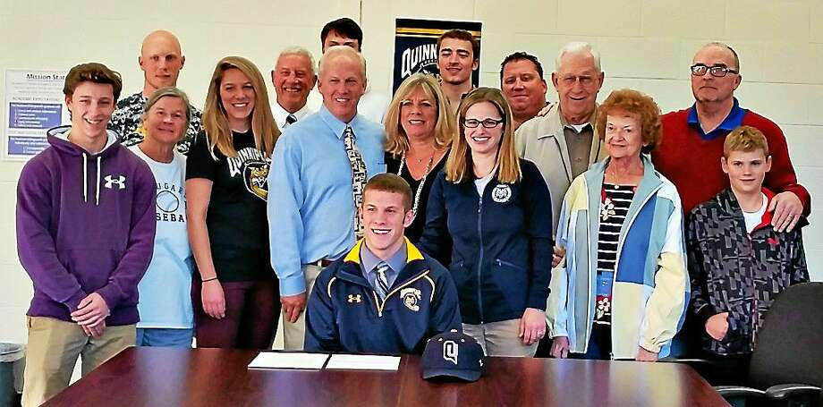 Haddam-Killingworth senior Brian Moskey is surrounded by family, friends and coaches as he signs a National Letter of Intent to play baseball at Quinnipiac University in Hamden. Brian's family, center from left, include sister Kellie, parents Frank and Cindy Moskey, and grandparents Frank Sr. and Lorraine Moskey. Also pictured are H-K coach Mark Brookes and his wife, Rae, and H-K athletic director Lynne Flint. Photo: Derek Turner — GameTimeCT.com