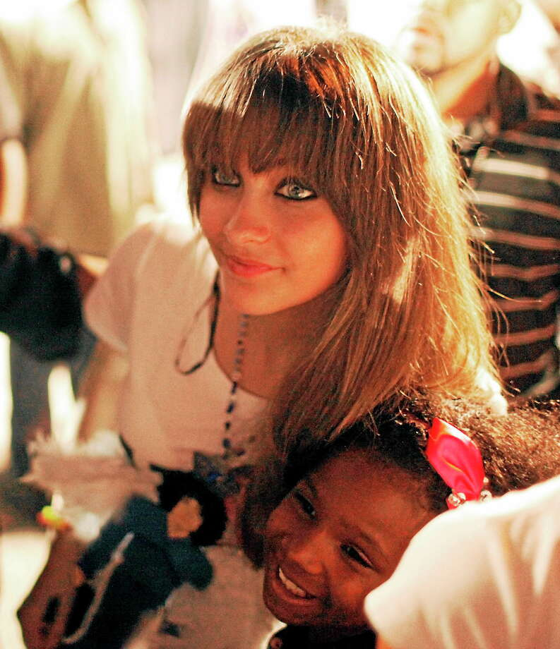 Paris Jackson, daughter of entertainer Michael Jackson, poses with a fan outside Jackson's boyhood home during a celebration on what would have been Jackson's 54th birthday on Aug. 29, 2012, in Gary, Ind. Photo: AP Photo/Sitthixay Ditthavong  / AP
