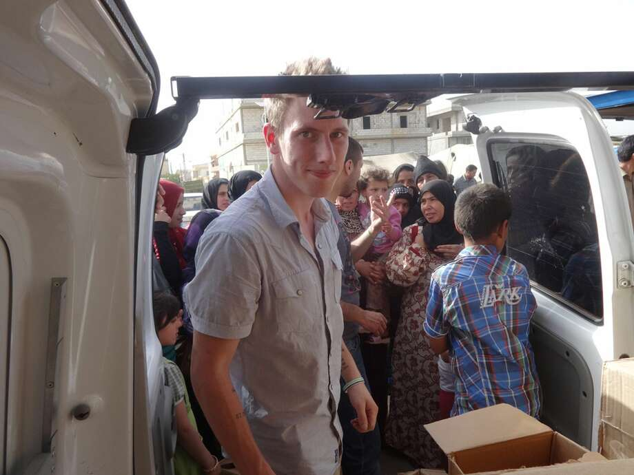 This undated photo provided by the Kassig Family shows Peter Kassig delivering supplies for Syrian refugees. Photo: AP Photo/Courtesy Kassig Family  / Kassig Family