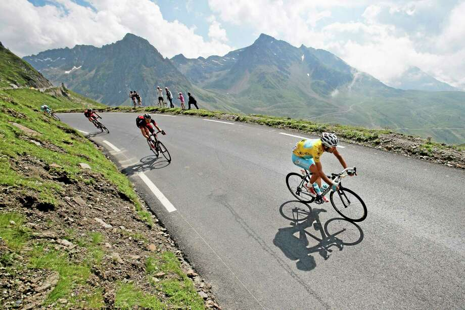 Stage winner Vincenzo Nibali, wearing the overall leader's yellow jersey, speeds down Tourmalet pass during the eighteenth stage of the Tour de France on Thursday, which started in Pau and finished in Hautacam, Pyrenees region, France. Photo: Christophe Ena — The Associated Press  / AP