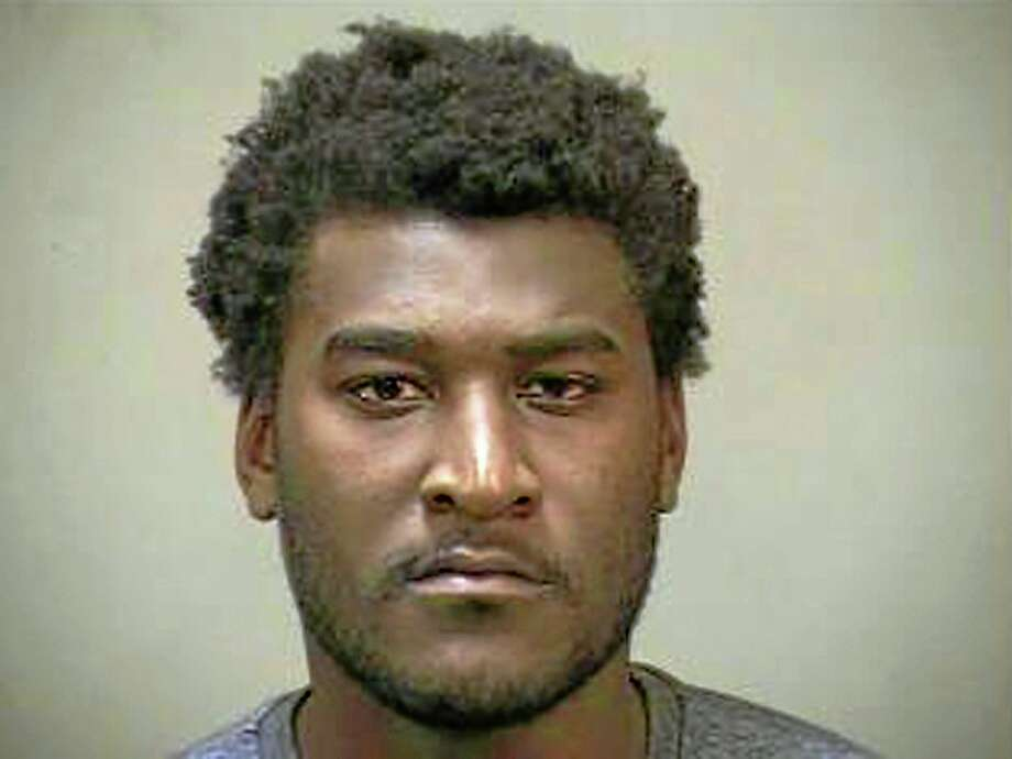 In this photo provided by the Edmond (Okla.) Police Department, Justin Blackmon is pictured in a booking photo. Blackmon, a former standout at Oklahoma State, was arrested Wednesday evening in the Oklahoma City suburb of Edmond on a complaint of marijuana possession. Photo: Edmond Police Department — The Associated Press  / Edmond Police Department