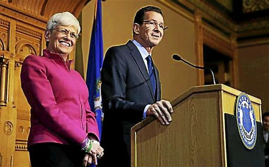 Gov. Dannel Malloy stands with Lt. Gov. Nancy Wyman, left, as they thank supporters Nov. 5 at the State House in Hartford. Photo: Associated Press  / AP