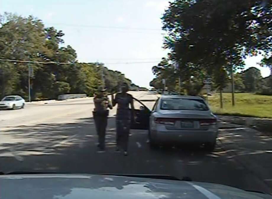 In this July 10 frame from dashcam video provided by the Texas Department of Public Safety, trooper Brian Encinia arrests Sandra Bland after she became combative during a routine traffic stop in Waller County, Texas. Photo: Texas Department Of Public Safety Via AP / Texas Department of Public Safety