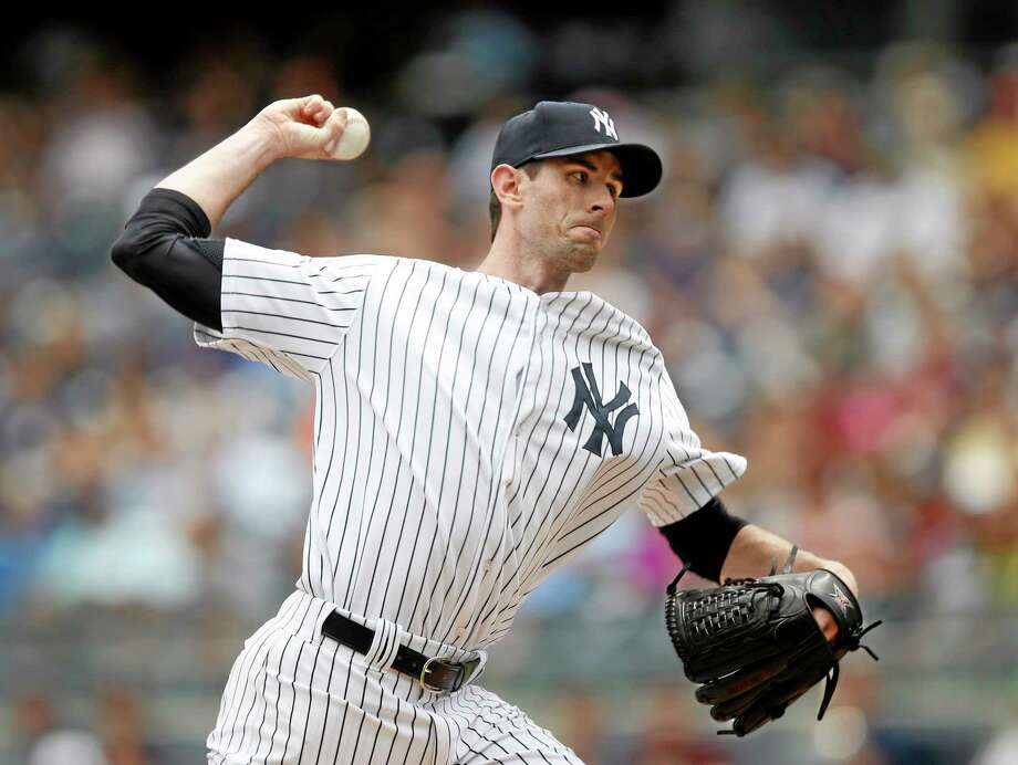 The Associated Press Yankees starting pitcher Brandon McCarthy delivers in the first inning of Thursday's game against the Texas Rangers at Yankee Stadium in New York. Photo: AP / AP
