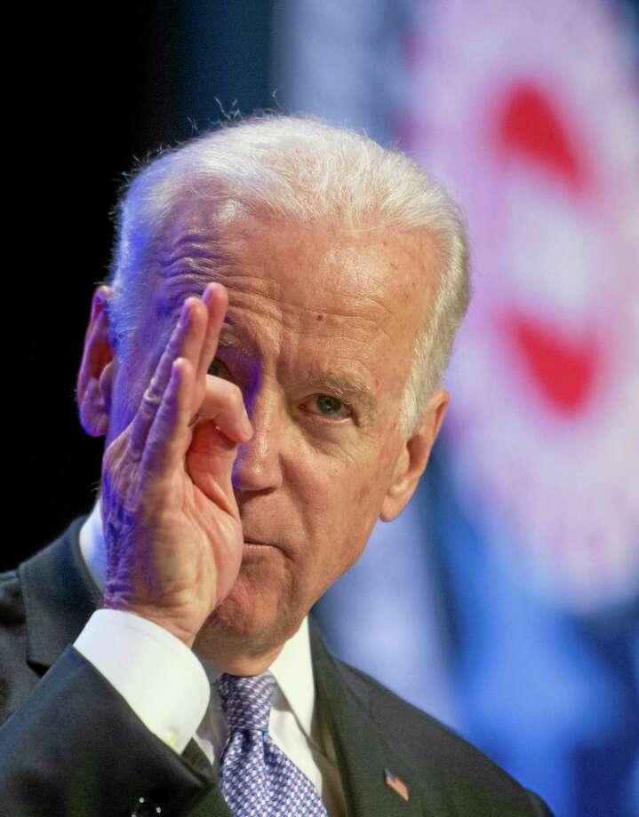 Vice President Joe Biden gestures while speaking the 2014 UAW National Community Action Program Conference in Washington, Wednesday, Feb. 5, 2014. (AP Photo/Cliff Owen)5 Photo: AP / FR170079 AP