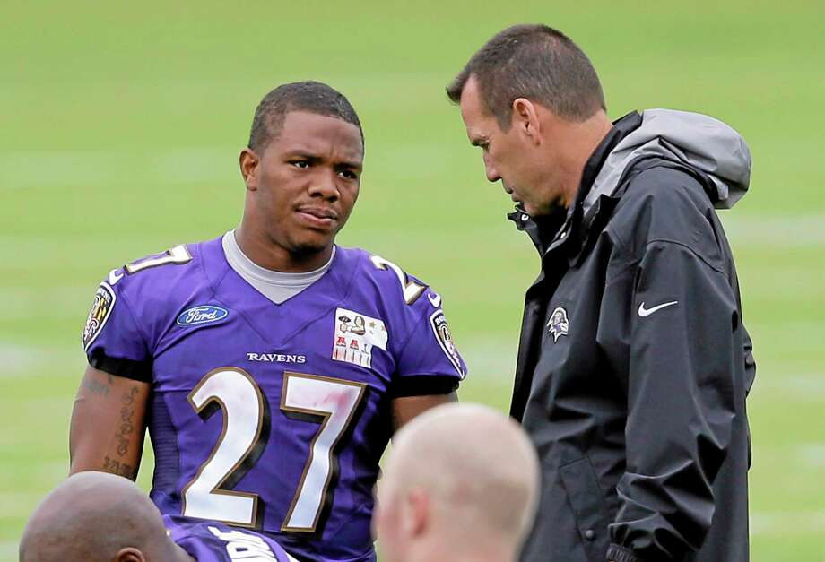Baltimore Ravens running back Ray Rice speaks with offensive coordinator Gary Kubiak at the end of Thursday's practice at the team's facility in Owings Mills, Md. Photo: The Associated Press  / AP