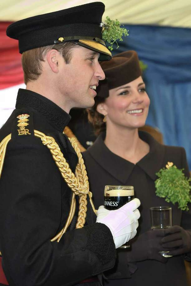 Britain's Kate, the Duchess of Cambridge and her husband Prince William during a visit to the 1st Battalion Irish Guards at the St. Patrick's Day Parade at Mons Barracks, Aldershot, in England, Tuesday, March 17, 2015. The Duke of Cambridge attended the Parade as Colonel of the Regiment. The Duchess of Cambridge presented the traditional sprigs of shamrocks to the Officers and Guardsmen of the Regiment. (AP Photo/Eddie Mulholland, Pool) Photo: AP / The Telegraph NPA Pool