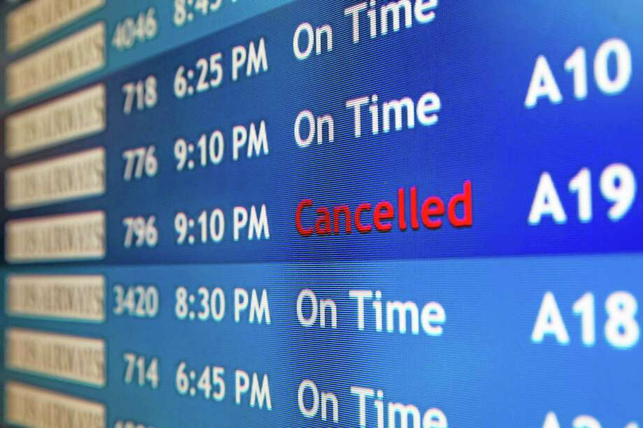 A departure board at the Philadelphia International Airport shows that US Airways Flight 796 to Tel Aviv has been canceled, Tuesday, July 22, 2014, in Philadelphia. The Federal Aviation Administration is telling U.S. airlines they are prohibited from flying to the Tel Aviv airport in Israel for 24 hours after a Hamas rocket exploded nearby. (AP Photo/Matt Rourke) Photo: AP / AP