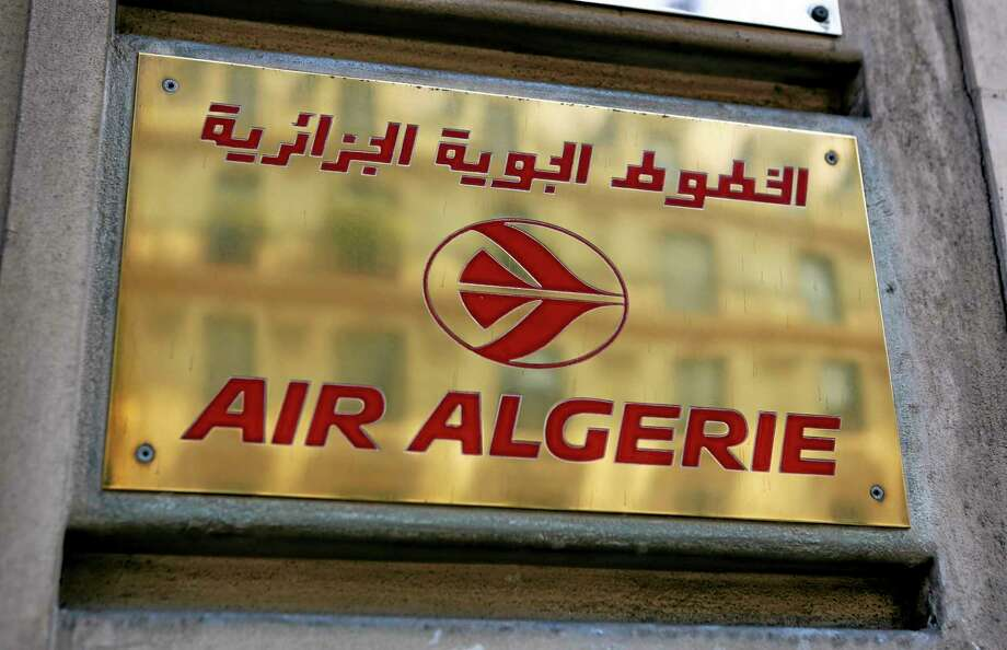 The logo of the Air Algerie company office, at the Opera avenue in Paris Thursday. A flight operated by Air Algerie has disappeared from radar while traveling from Burkina Faso in West Africa to Algiers. Authorities say it was carrying over 100 passengers and crew when air navigation services lost track of the Swiftair plane 50 minutes after takeoff earlier this morning. Photo: Associated Press  / AP