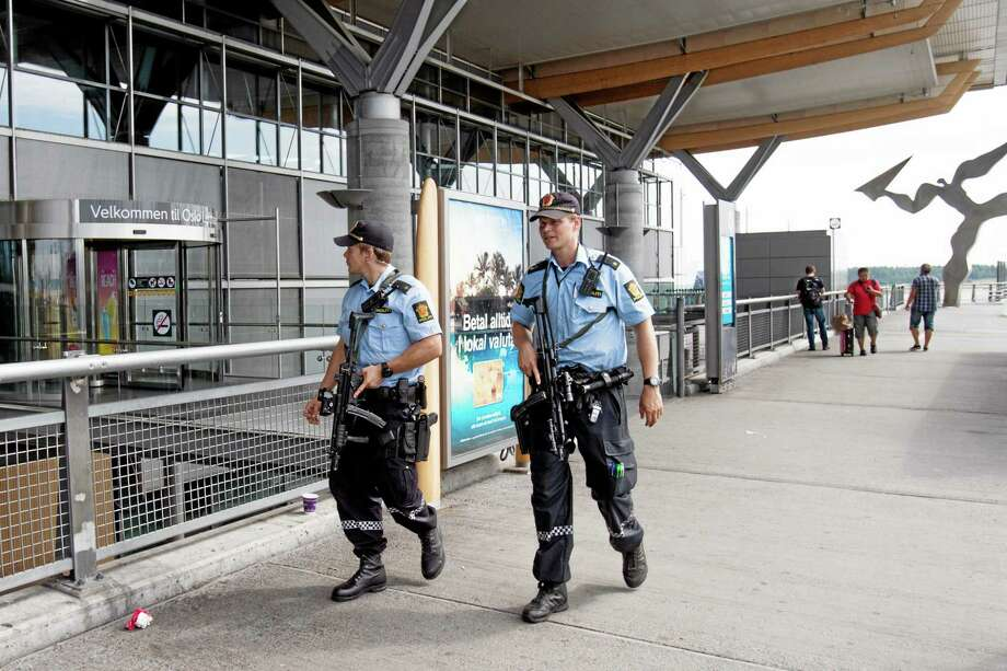 "Armed Police patrol outside the terminal building Thursday at Oslo Airport. Norway's intelligence service says it has been warned of an imminent ""concrete threat"" against the nation from people with links to Islamic fighters in Syria. Photo: Associated Press  / NTB scanpix"