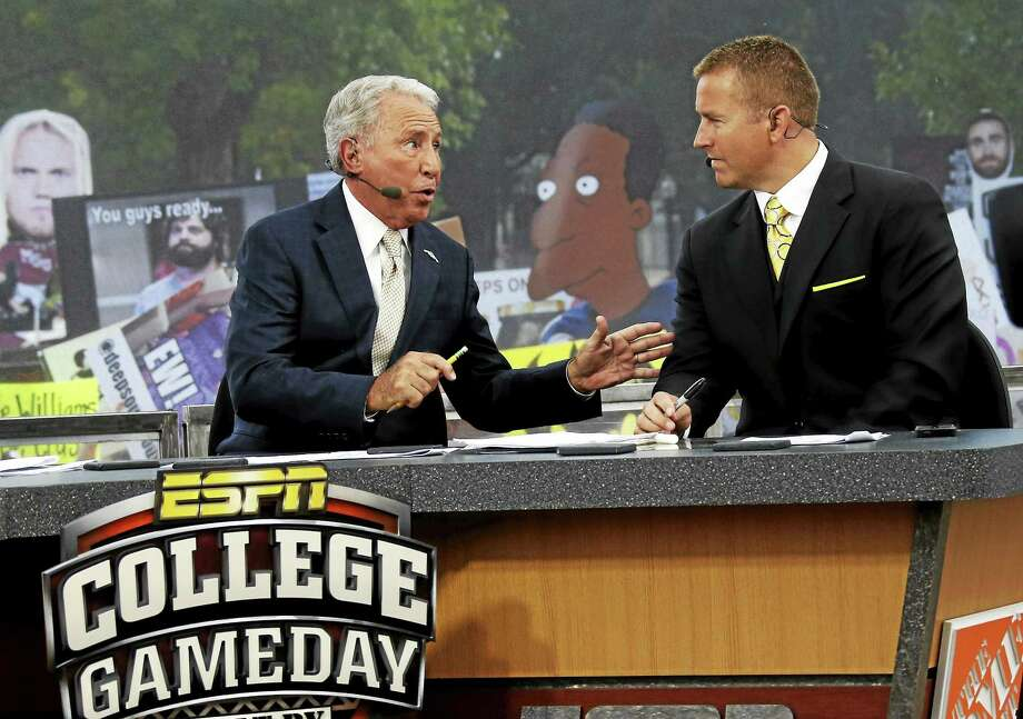 ESPN College GameDay hosts Lee Corso, left, and Kirk Herbstreit will broadcast Saturday from the Yale-Harvard game in Cambridge, Mass. Photo: The Associated Press File Photo  / AP