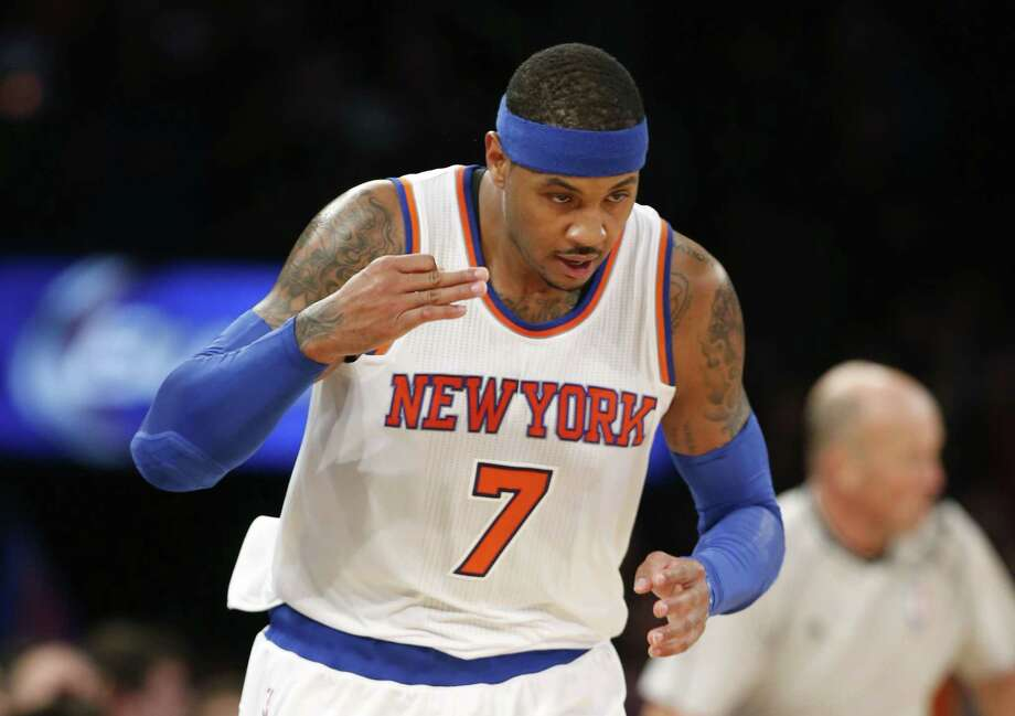 Knicks forward Carmelo Anthony (7) salutes the crowd after hitting a 3-pointer on Sunday. Photo: Kathy Willens — The Associated Press  / AP