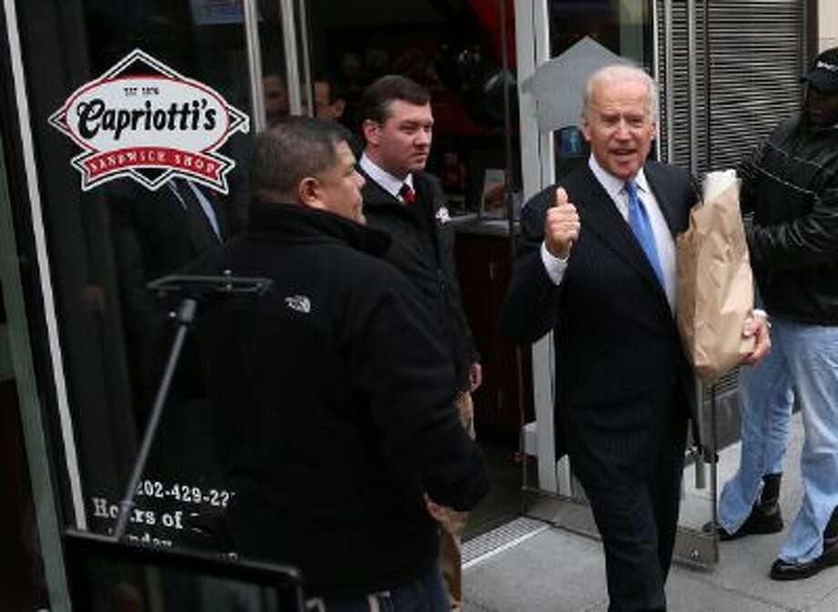 Vice President Joe Biden walks out of Capriotti's sandwich shop after picking up his lunch on November 21, 2013 in Washington, DC. Capriotti's is a Delaware based Italian hoagie chain and a favorite of the Vice President. (Photo by Mark Wilson/Getty Images) Photo: Getty Images / 2013 Getty Images