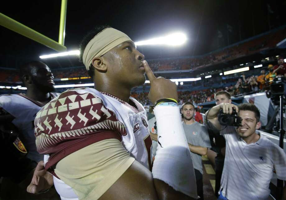 Florida State quarterback Jameis Winston gestures to the crowd after Florida State defeated Miami 30-26 on Saturday. Photo: The Associated Press  / AP