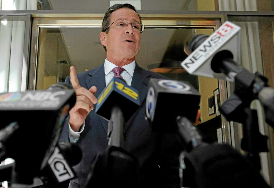 Connecticut Gov. Dannel P. Malloy briefly speaks to the media in a file photo. (AP Photo/Jessica Hill) Photo: AP / FR125654 AP