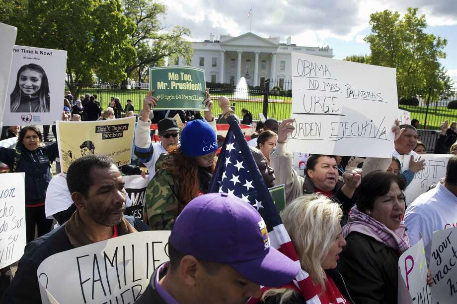 In this Nov. 7, 2014 photo, people rally for comprehensive immigration reform outside the White House in Washington. Photo: AP Photo/Jacquelyn Martin  / AP