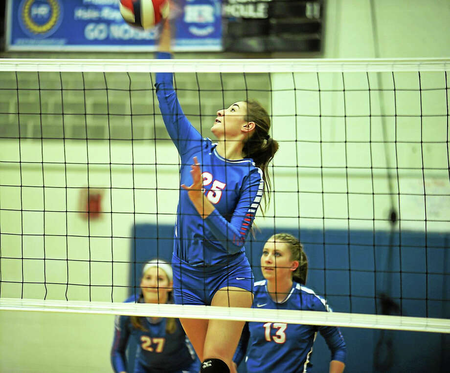 Hale-Ray senior Andrea Wordell delivers one of her match-high 11 kills in the Noises' 3-0 sweep over Goodwin Tech Wednesday in Moodus. Photo: Jimmy Zanor — Middletown Press