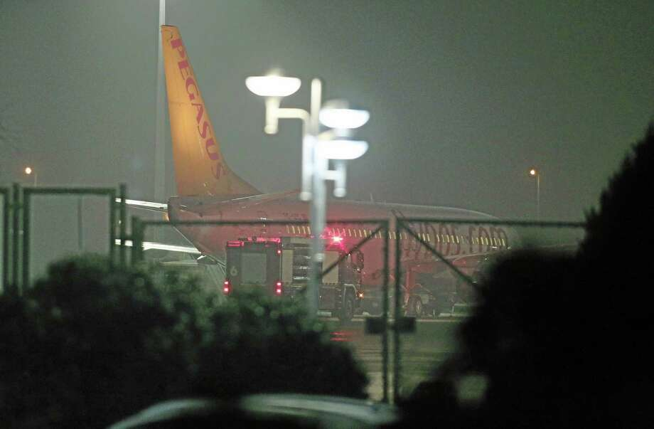 "Turkish private company Pegasus passenger plane at the Sabiha Gokcen Airport in Istanbul, Turkey, Friday, Feb. 7, 2014, after a Ukrainian passenger on board Istanbul-bound flight claimed there was a bomb on board and tried to hijack the plane to Sochi, Russia, where the winter Olympics are kicking off, an official said. All 110 passengers aboard the plane were evacuated ""without any problems"" after authorities subdued the man who attempted to hijack the Turkish plane to Sochi, Russia.(AP Photo/Emrah Gurel) Photo: AP / AP"