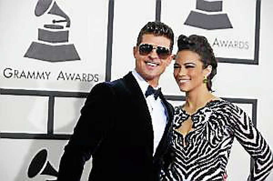 Robin Thicke and Paula Patton arrive at the 56th annual Grammy Awards at Staples Center on Sunday, Jan. 26, 2014, in Los Angeles. Photo: (Jordan Strauss — The Associated Press)