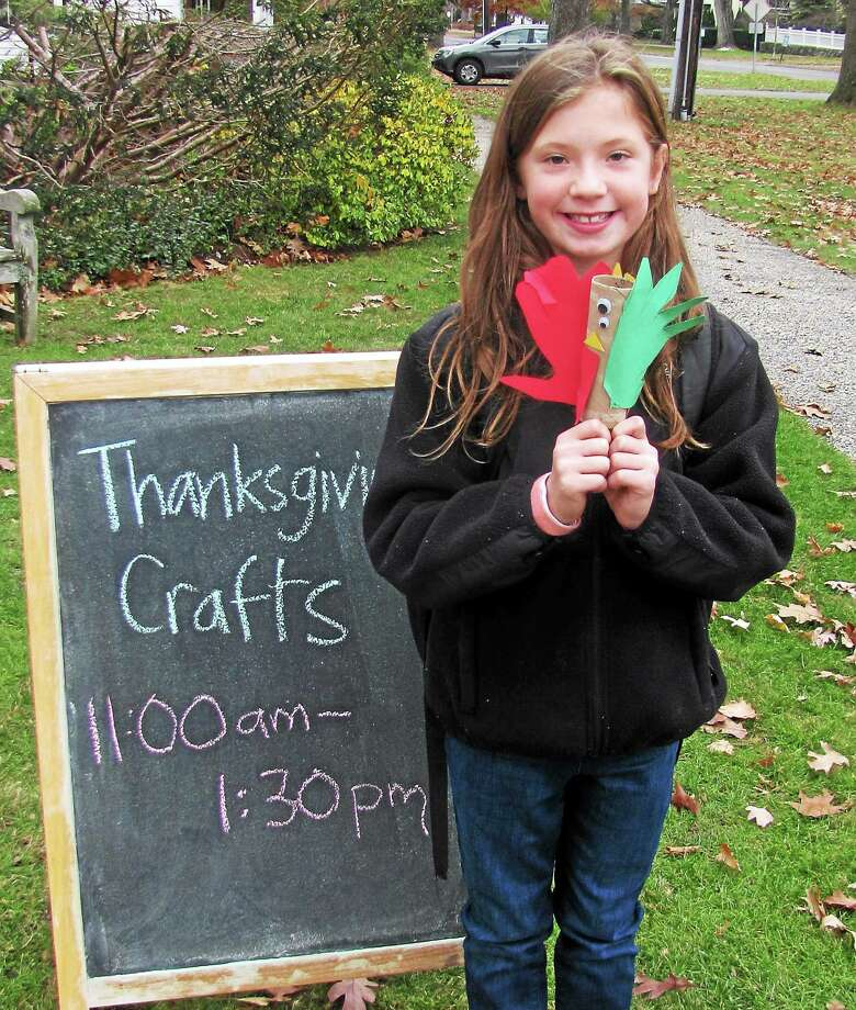 The Litchfield Historical Society hosted a Thanksgiving crafts workshop Sunday at the Litchfield History museum, allowing families to create hand-made items incluing a turkey with hand-cut tail feathers, a pumpkin and a thankful wreath. Photo: John Nestor —Special To The Register Citizen