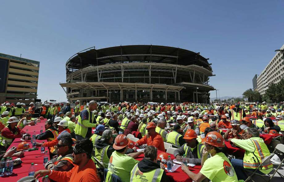 In this April 7 file photo, construction works eat lunch by an MGM arena being built behind the New York-New York casino-hotel in Las Vegas. Photo: John Locher — The Associated Press File Photo  / AP