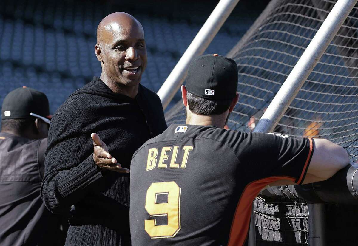 Barry Bonds, left, talks with first baseman Brandon Belt during batting practice before a game between the Giants and the Philadelphia Phillies on July 10 in San Francisco.