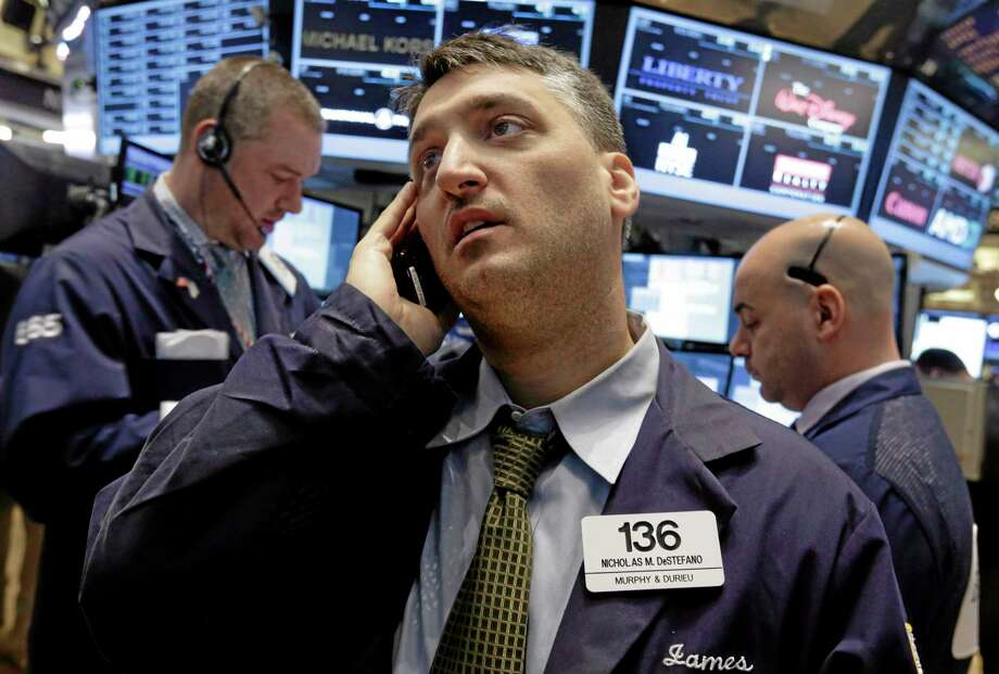 In this Feb. 5 photo, trader Nicholas DeStafano, center, works on the floor of the New York Stock Exchange. Photo: Richard Drew — The Associated Press  / AP