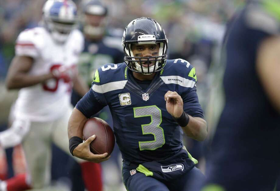 Russell Wilson and the Seahawks ran all over the New York Giants last Sunday in Seattle. Photo: Scott Eklund — The Associated Press  / FR159797 AP