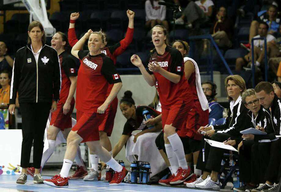 Team Canada reacts to a 3-pointer by Kia Nurse against the United States during the second quarter of the gold medal game at the Pan Am Games on Monday in Toronto. Photo: Julio Cortez — The Associated Press  / AP