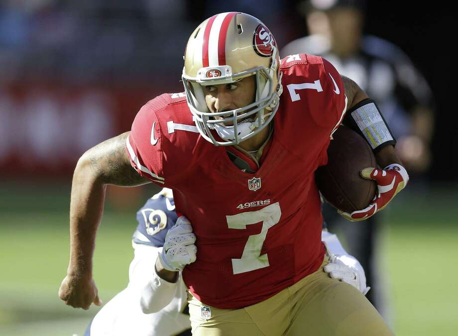 If last week was any indication, look for 49ers quarterback Colin Kaepernick to try to run the ball against what has been a porous Giants defense. Photo: The Associated Press File Photo  / AP