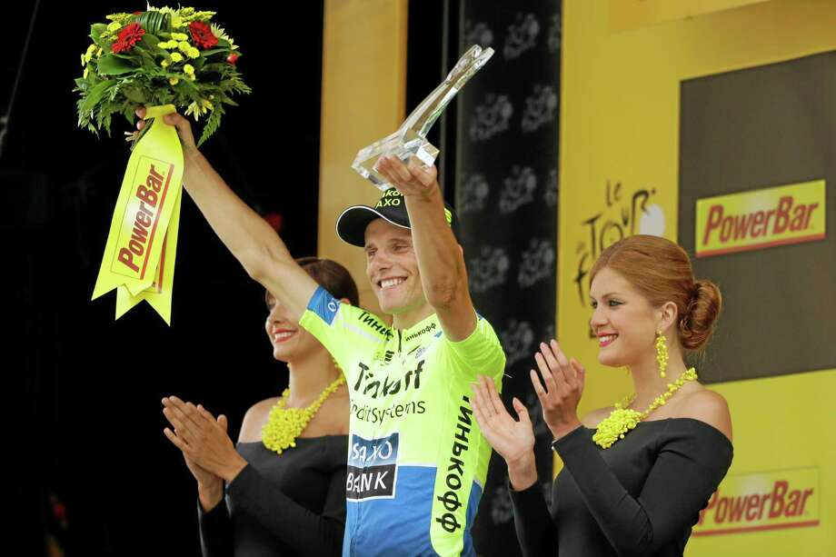 Stage winner Rafal Majka celebrates on the podium of Wednesday's seventeenth stage of the Tour de France, which went from Saint-Gaudens to Saint-Lary, France. Photo: Laurent Cipriani — The Associated Press  / AP