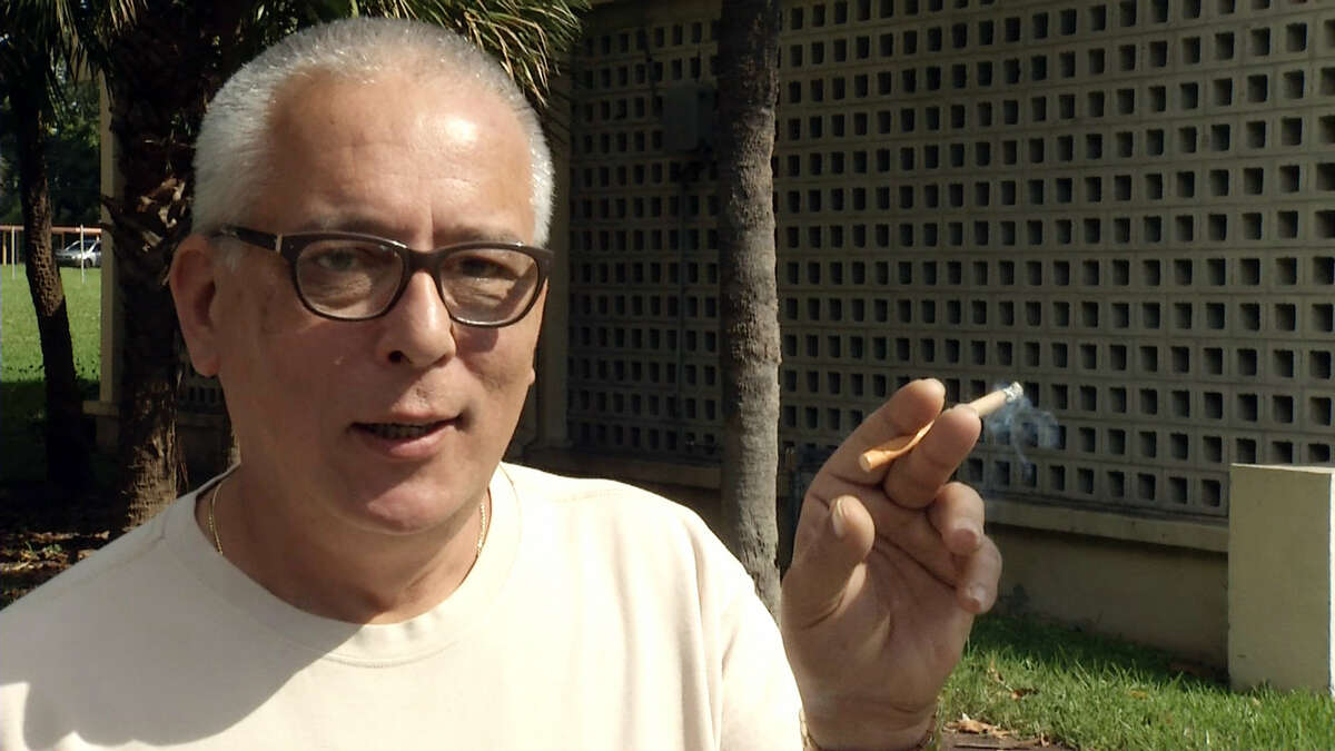 In this image taken from video, Gerardo Barro, a resident of the Robert King High Towers, a public housing complex near the Miami's Marlins Park baseball stadium, speaks to a reporter Thursday in Miami.
