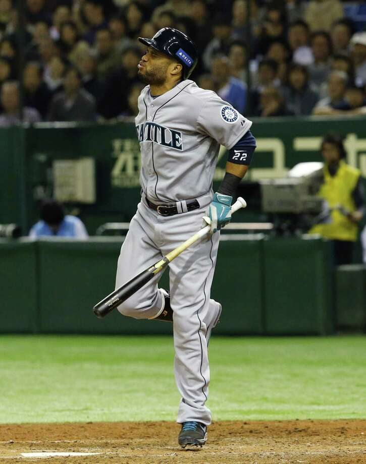 Robinson Cano grimaces after getting hit by a pitch from Japan pitcher Yuki Nishi in the seventh inning of Game 3 of the MLB All-Stars' exhibition series at the Tokyo Dome on Saturday. Photo: Toru Takahashi — The Associated Press  / AP