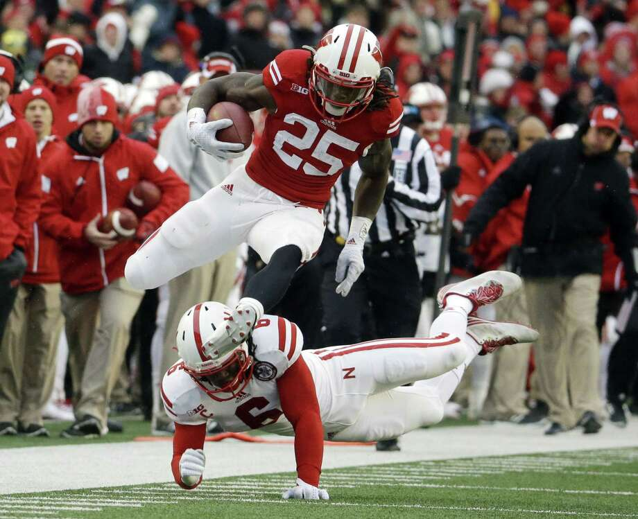 Wisconsin's Melvin Gordon (25) breaks away from Nebraska's Corey Cooper for a 62-yard touchdown run during the first half of Saturday's game in Madison, Wis. Photo: Morry Gash — The Associated Press  / AP