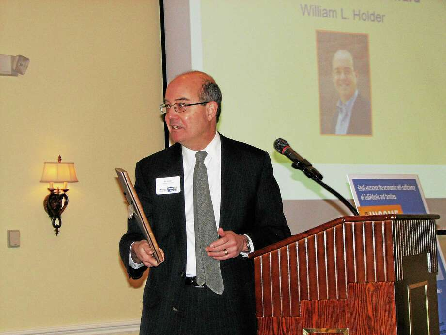 Submitted photo Bill Holder accepts the Community Service Award at Middlesex United Way's annual meeting. Photo: Journal Register Co.