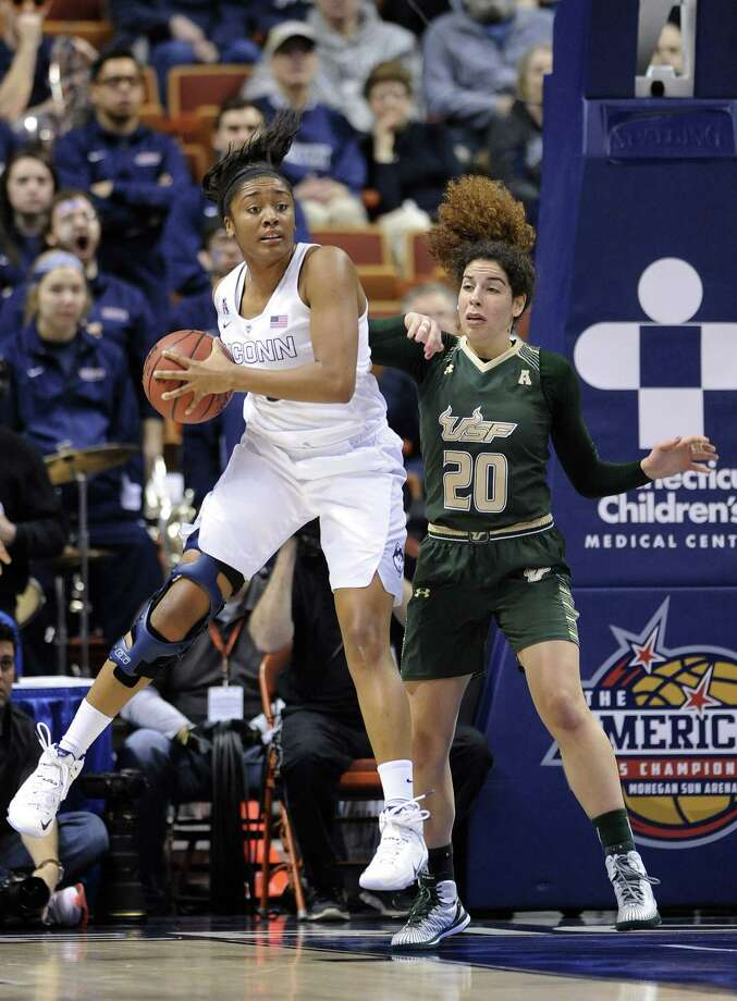 UConn's Morgan Tuck grabs a rebound during a recent game against USF. Photo: The Associated Press File Photo  / FR153656 AP