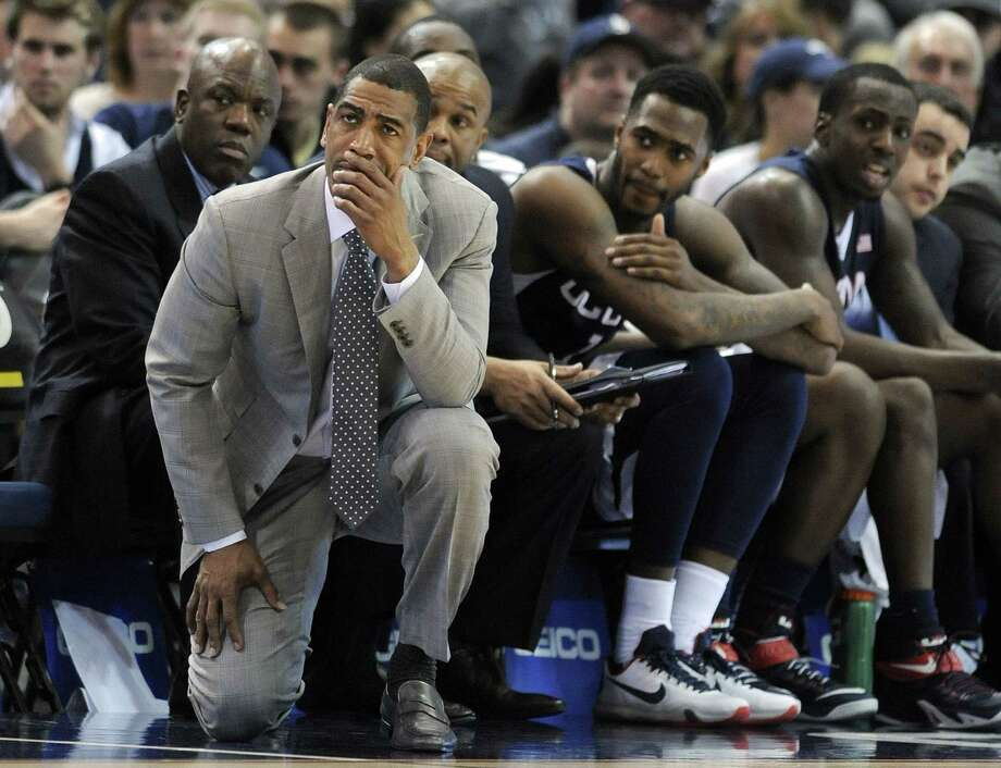 UConn coach Kevin Ollie and his team react late in the second half Sunday. Photo: Fred Beckham — The Associated Press  / FR153656 AP