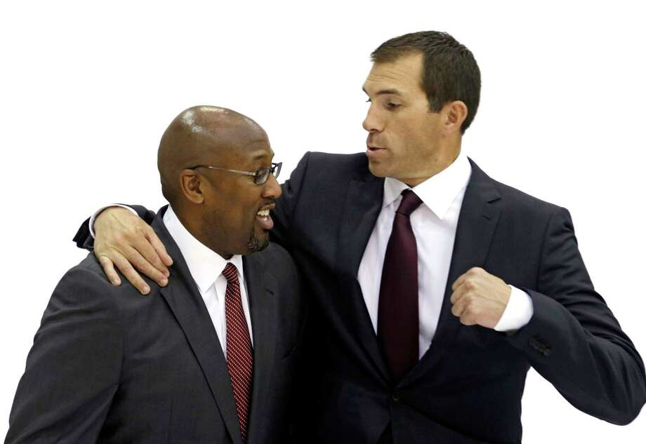 The Cleveland Cavaliers on Thursday fired general manager Chris Grant, here pretending to punch head coach Mike Brown during media day in September. Photo: Tony Dejak — The Associated Press  / AP