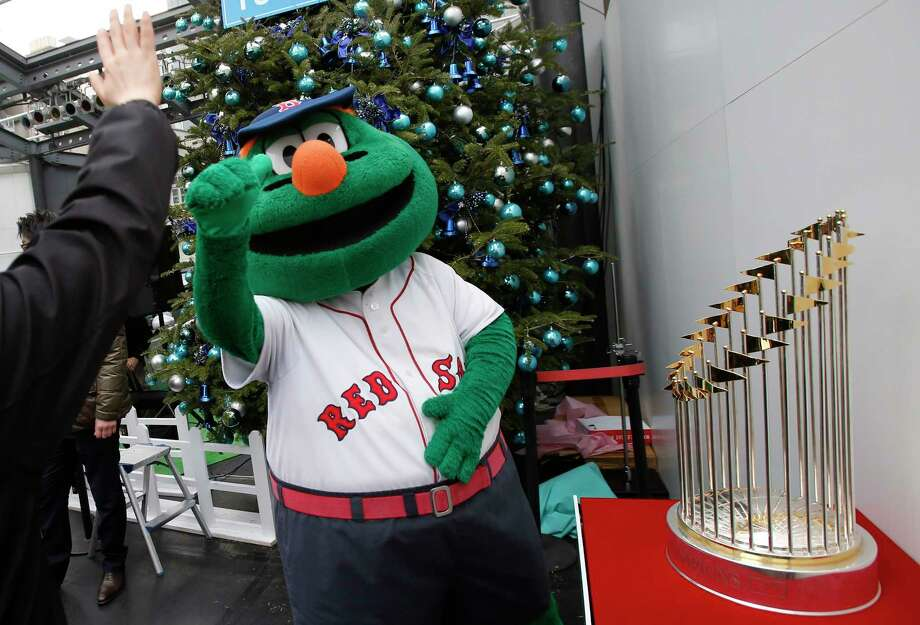 The Boston Red Sox's 2013 World Series trophy will be in Waterbury and Hartford on Sunday. No word yet on Wally the Green Monster. Photo: Shizuo Kambayashi — The Associated Press  / AP