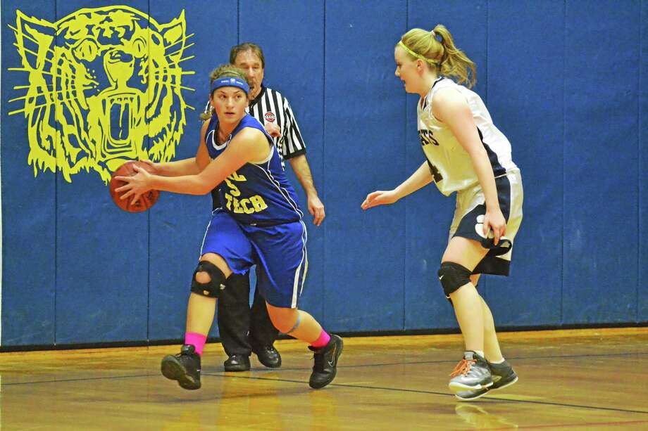 Vinal Tech's Karen Agogliati looks for a teammate to pass to during the Hawks 43-38 loss to Wolcott Tech. Photo: Pete Paguaga — Register Citizen