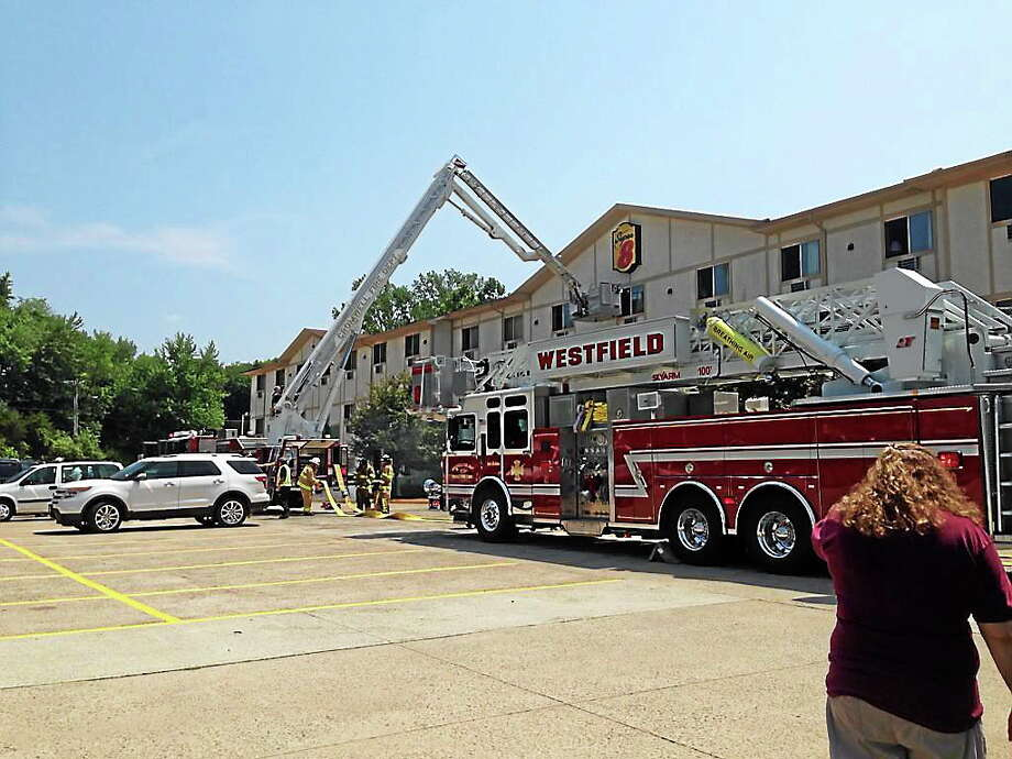 Firefighters knocked down a two-alarm fire at the Super 8 Hotel in Cromwell late Wednesday morning. The cause of the blaze was not immediately clear. Photo: (Kaitlyn Schroyer -- Middletown Press)