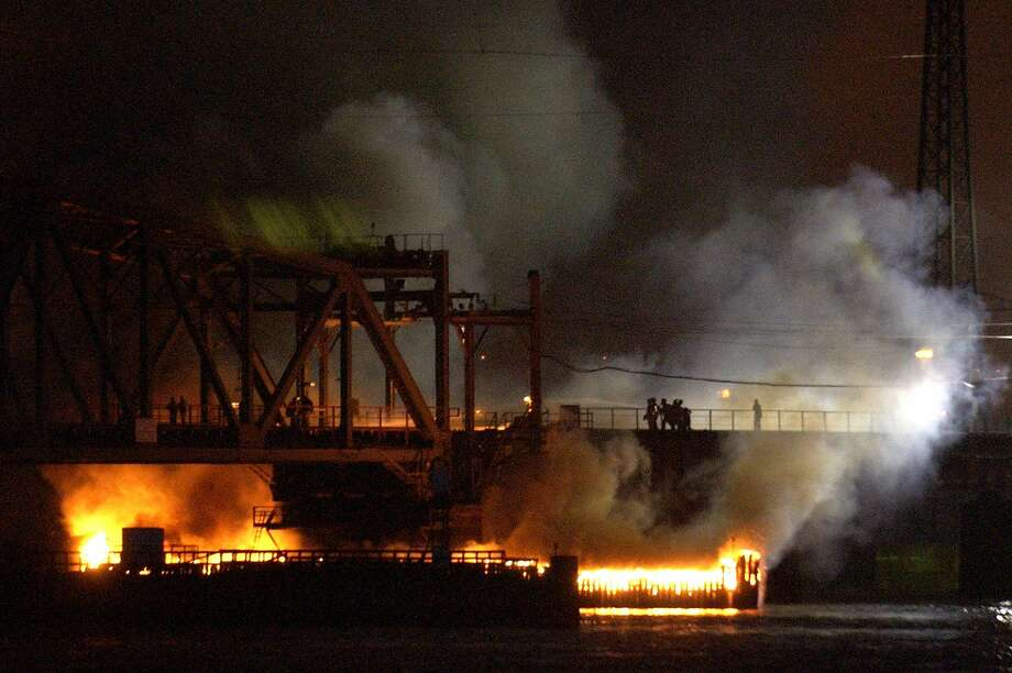FILE -- In this May 12, 2005, photo, a portal bridge burns after a fast-moving fire engulfed the railroad bridge, disrupting New Jersey Transit and Amtrak service on the Northeast Corridor. A plan to replace the bridge has pushed forward and could be finished in less than four years _ provided about $940 million can be found to complete the project. Amtrak and New Jersey Transit carry between 150,000 and 200,000 people across the bridge each day.  (AP Photo/Bill Kostroun, File) Photo: AP / ap